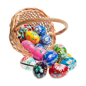 Hand crafted wooden Easter Eggs spilling out of a basket